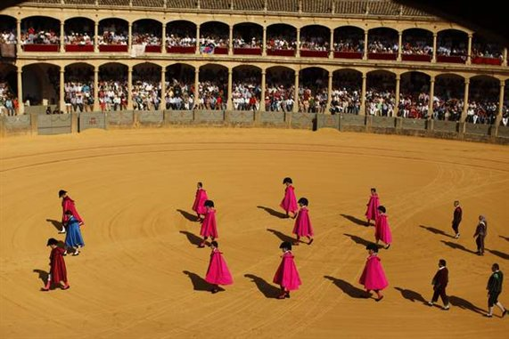 spanish-bullfighters-and-their-assistants-make-the-paseillo-before-before-a-corrida-goyesca-bullfight-in-ronda$0x381-L